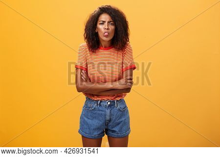 Immature Girl Showing Bad Side Of Character. Portrait Of Childish Offended Or Displeased Young Afric