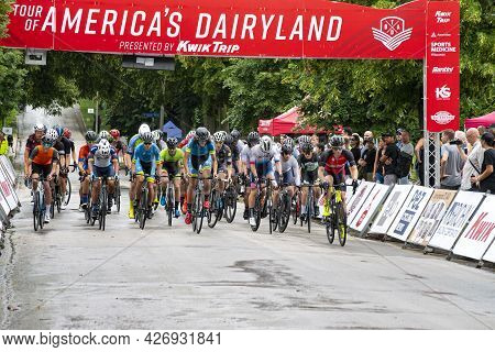 Wauwatosa, Wi/usa - June 26, 2021: Category Three Four Men Cyclists Take Off From Starting Line At W