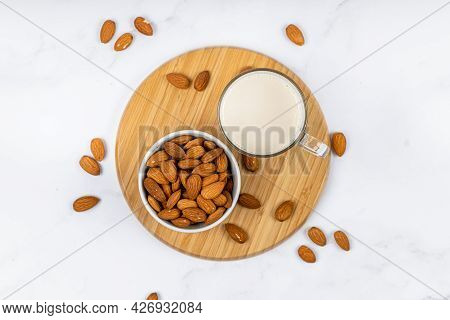 Almond Milk In A Glass With Almond On A Wooden Table