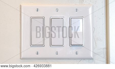 Pano Rocker Light Switch With Multiple Flat Broad Lever Mounted On The Interior Wall