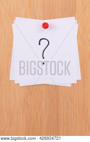 White Sticky Notes With Question Mark Pinned To The Wooden Message Board. To Do List Reminder In The