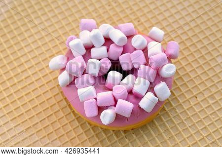Appetizing Donut In Pink Glaze With Marshmallow Close-up