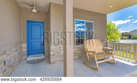 Pano Facade Of House With Keypad Lockbox On The Blue Front Door For Security