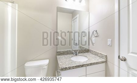 Pano Small White Bathroom Interior With Ambient Lightnings And Closed White Door
