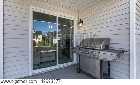 Pano Exterior Of A House With A Sliding Glass Door And Vinyl Sidings
