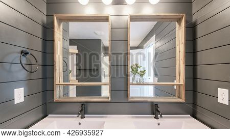 Pano Alcove Double Sink With Ambient Lightnings And Gray Walls With Horizontal Line Design