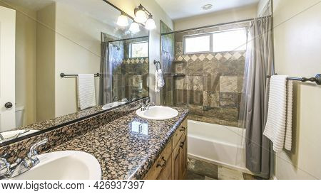 Pano Bathroom Interior With Marble Tiles And Double Vanity Sink With Granite Top