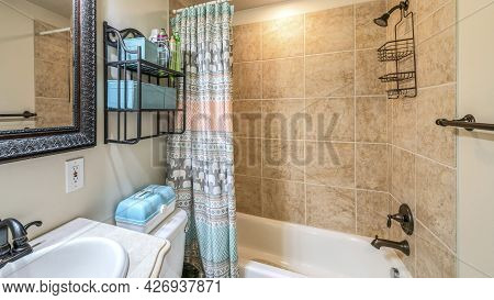 Pano Bathroom Interior With Antique Fixtures And Ceramic Tile Walls