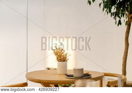 Cup Of Coffee On A Wooden Table In The Interior Of A Cafe. Lifestyle Concept. Copy Space