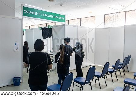 Kuala Lumpur, Malaysia, July 16, 2021: People Waiting For Their Turn To Go Into Covid-19 Vaccination