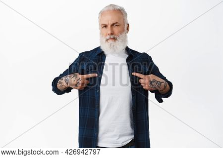 Confused Bearded Old Man With Tattoos Pointing At Himself, Being Puzzled Or Doubtful, Having Disbeli
