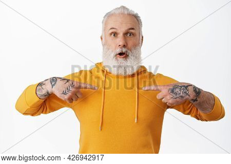 Surprised Mature Bearded Guy With Tattoos Pointing At Himself, Gasping Amazed In Disbelief, Being Ch