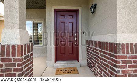 Pano Red Front Door Porch Exterior With Bricks And Welcome Doormat