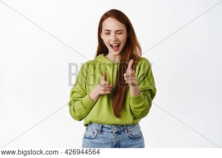 Nice Work, Congrats. Smiling Redhead Woman Winking And Pointing Finger Pistols At Camera, Choosing Y