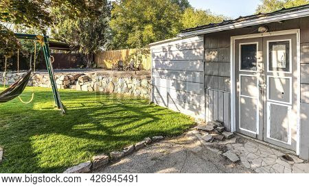 Pano Tool Shed At The Backyard With Cracked Concrete Flooring At The Entrance