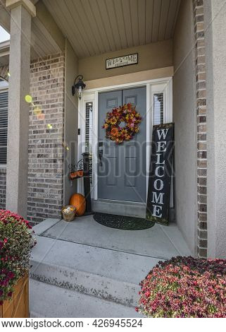 Vertical Front House Design With Bricks And Halloween Ornaments At The Front