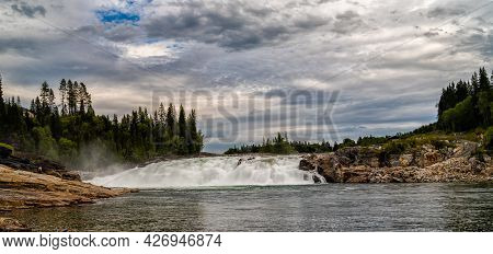 Landscape View Of The Wild And Massive Laksforsen Waterfall Noear Trofors
