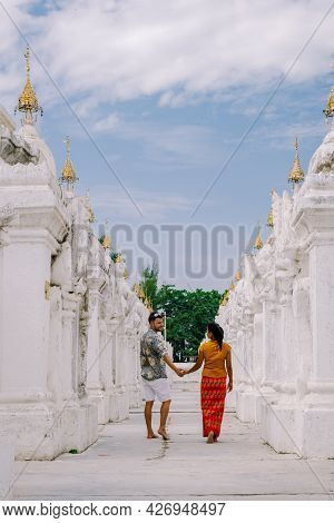 Mandalay Myanmar, Tourist Among Of Stupas In Kuthodaw Pagoda, Known As The Worlds Largest Book. Kuth