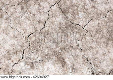 Soft Focus And Flat Lay Of Dry, Cracked Earth. The Concept Of Drought And Old Infertile Soil. Desert