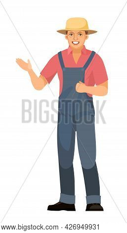 The Farmer Guy Is Standing. Young Handsome Cute Boy Wearing A Hat. Shows With His Hand. In Uniform,