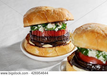 Close Up Of Eggplant Sandwich Burger With Feta Cheese And Cilantro. Plant Based Food Concept
