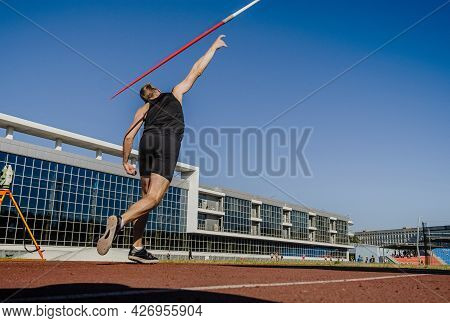 Back Male Athlete Javelin Throw At Athletics Competition