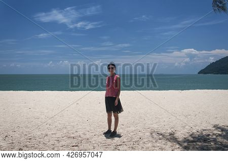 A Chinese Woman On Kearchut Beach Within Penang National Park In George Town Penang Malaysia On A Su