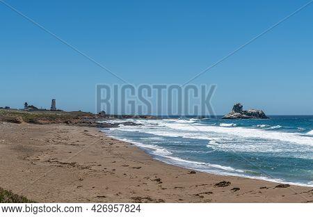 San Simeon, Ca, Usa - June 8, 2021: Pacific Ocean Coastline. Point Piedras Blancas With Light Statio
