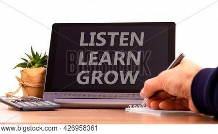Listen, Learn, Grow Symbol. Tablet With Words 'listen, Learn, Grow'. Businessman Holds Pen, House Pl