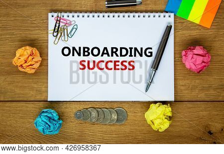 Onboarding Success Symbol. The Word 'onboarding Success ' On White Note. Wooden Table, Colored Paper