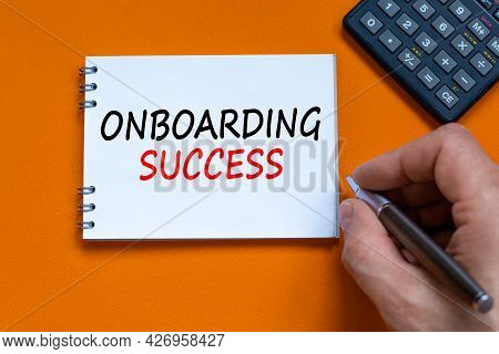 Onboarding Success Symbol. Businessman Writing Words Onboarding Success On White Note. Black Calcula
