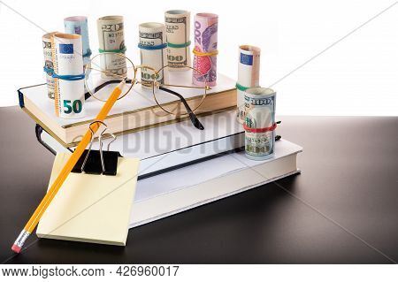 Money For Education. Money For Studies. Money And School Subjects. Glasses, Pencils And Stickers.