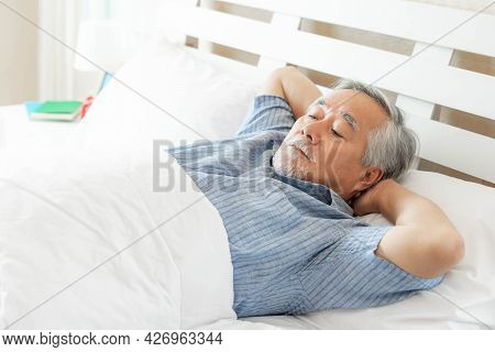 Senior man Suffering in bed cannot sleep from insomnia , Senior male , old man sleeping on bed in th