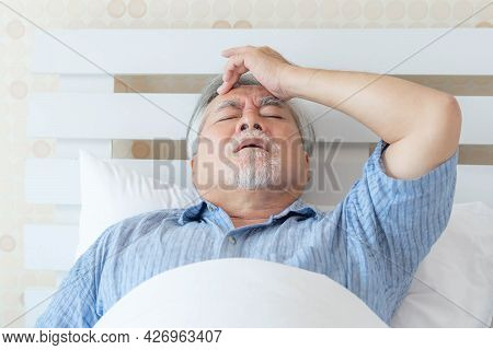Elderly patients in bed, Asian senior man patients Sore throat hands on neck - medical and healthcar