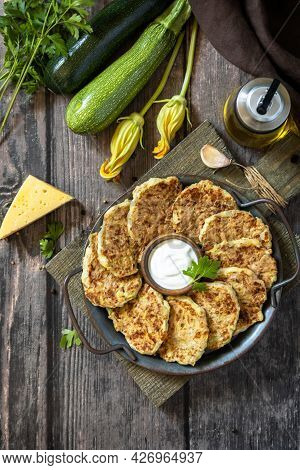 Healthy Summer Food, Zucchini Fritters. Vegetarian Zucchini Pancakes With Cheese, Served With Sour C