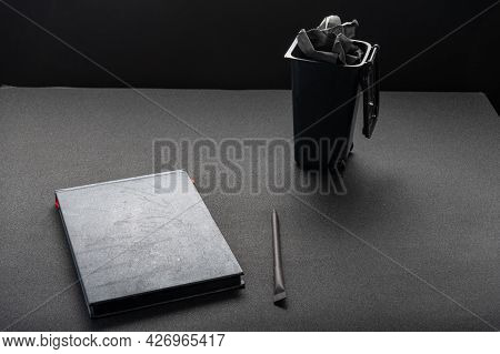 Notebook And Trash Can. Crumpled Paper In The Trash Bin. Search For An Idea. Delete Records In Trash