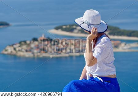 Tourist Woman In A White Straw Hat On Beautiful Blue Adriatic Sea And Cozy Island Background Croatia