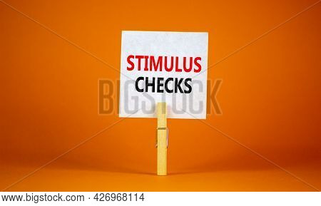Stimulus Checks Symbol. White Paper With Words 'stimulus Checks', Clip On Wooden Clothespin. Beautif