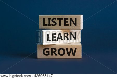 Listen, Learn And Grow Symbol. Wooden Blocks With Concept Words Listen, Learn, Grow. Beautiful Grey