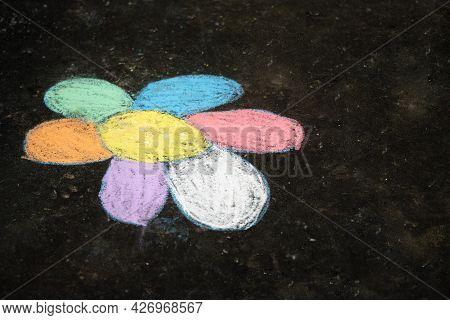 Childrens Chalk Drawing Of A Flower On The Asphalt