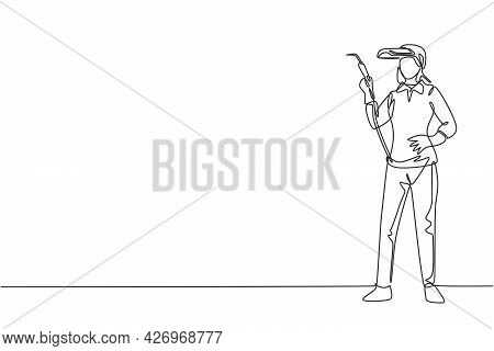 Continuous One Line Drawing Of Young Beauty Female Welder Holding Weld Nozzle With Hands On Hip. Pro