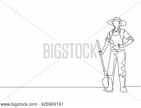 Continuous One Line Drawing Of Young Male Farmer Pose Standing On Field And Holding Shovel . Profess