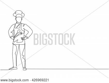 Single Continuous Line Drawing Of Young Male Chef Wearing Uniform Pose Standing At The Kitchen. Prof