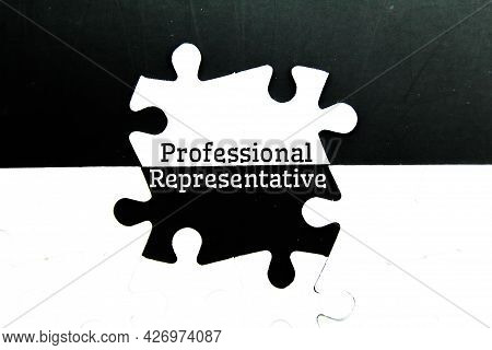 White Puzzle With The Word Professional Representative