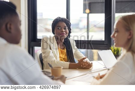 Group Of Multi Ethnic Business People Meeting, Communicate, Discuss Documents, And Work In A Meeting