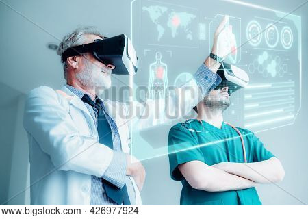 Physician Doctors Team Are Using Virtual Reality Technology For Examining Physical Anatomy Of Their