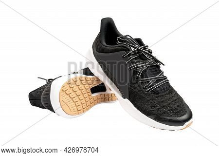 Sport Shoes And The Soles Of The Shoes, Modern Black Man Sports Shoes Isolated On A White Background