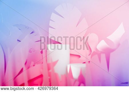 White Cylinder Podiums Among Paper Tropical Leaves. Showcase Podiums For Cosmetic Products.mock Up F