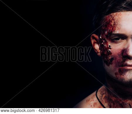 Close Up Halloween Portrait Man With Bloody Face On Black Background. 31 October. Best Ideas For Hal