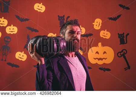 Funny Wise Wizard On A Halloween Background. Scary Hipster With Beard In Witch Hat And Plaid Shirt.